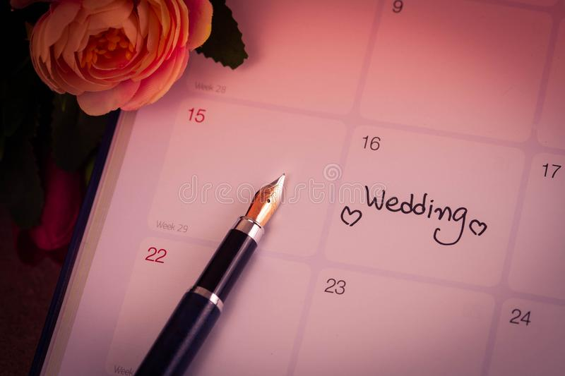 Reminder Wedding day in calendar planning. And fountain pen with color tone royalty free stock image