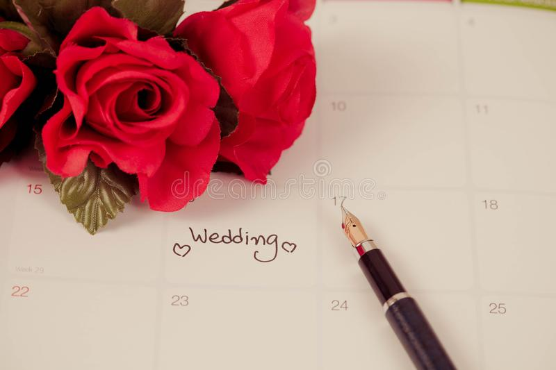 Reminder Wedding day in calendar planning. And fountain pen with color tone stock photos