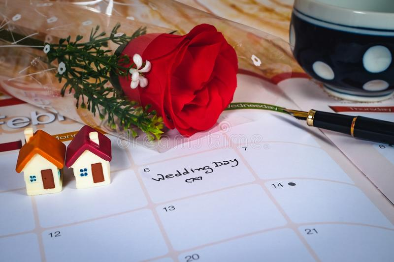 Reminder Wedding day in calendar planning and house. Reminder Wedding day in calendar planning and mini house royalty free stock photos