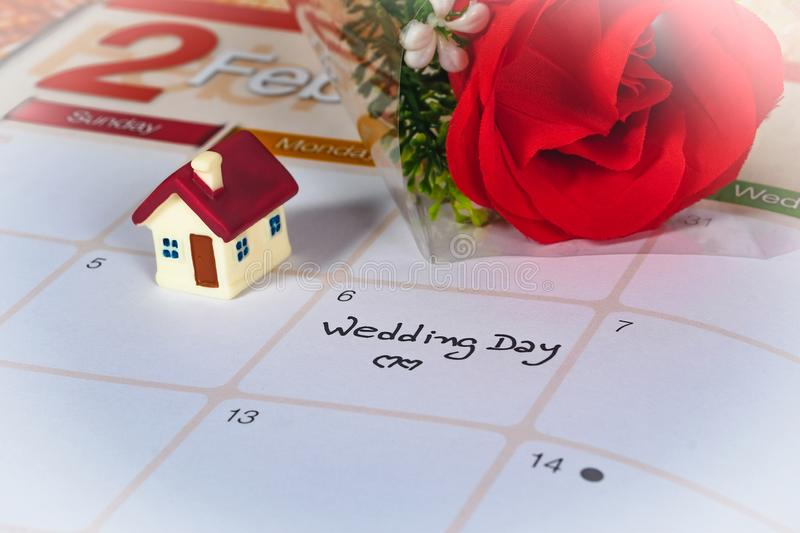 Reminder Wedding day in calendar planning and mini house. Reminder Wedding day in calendar planning and house royalty free stock photo