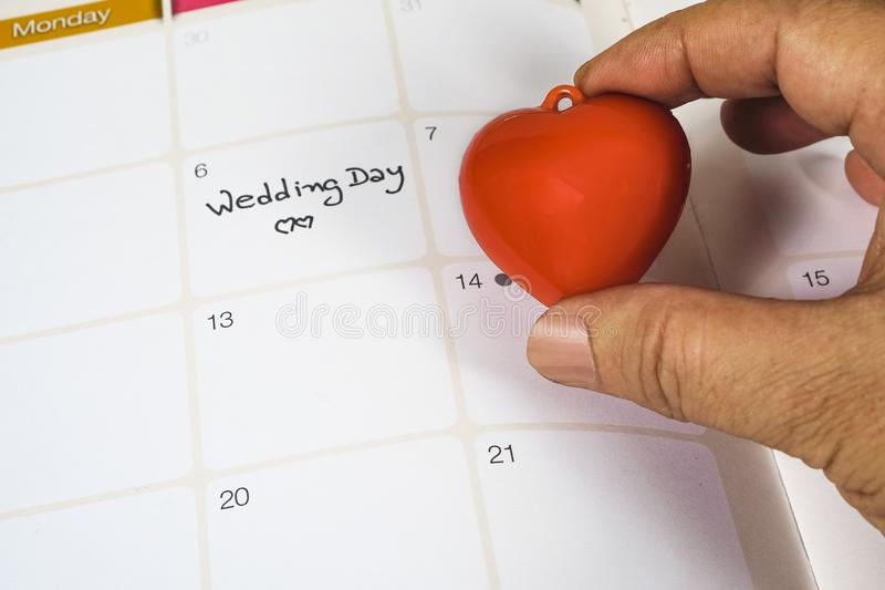 Reminder Wedding day in calendar planning and red heart. Sign royalty free stock photo