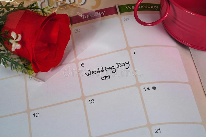 Reminder Wedding day in calendar planning with red rose. Reminder Wedding day in calendar planning with rose stock photo