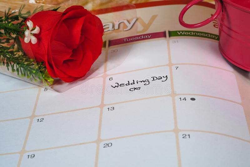 Reminder Wedding day in calendar planning with rose. Reminder Wedding day in calendar planning with red rose stock photography