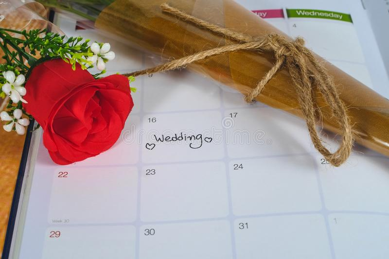 Reminder Wedding day in calendar planning with rose. Reminder Wedding day in calendar planning with red rose stock images