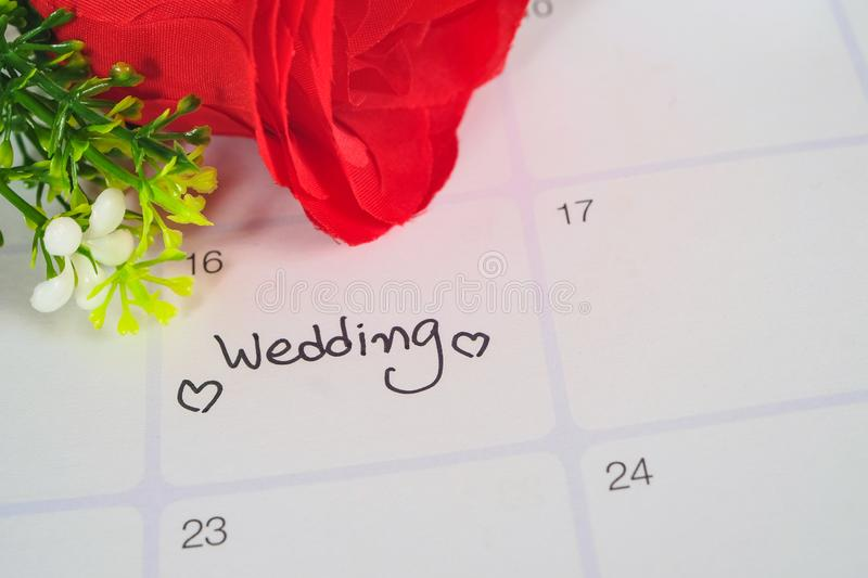Reminder Wedding day in calendar planning with rose. Reminder Wedding day in calendar planning with red rose stock image