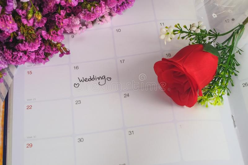 Reminder Wedding day in calendar planning with rose. Reminder Wedding day in calendar planning with red rose royalty free stock images