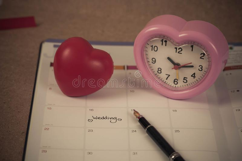 Reminder Wedding day in calendar planning. And fountain pen with color tone royalty free stock photo