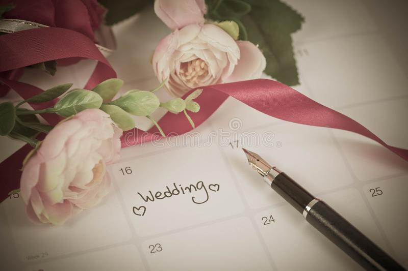Reminder Wedding day in calendar planning. And fountain pen with color tone royalty free stock photography
