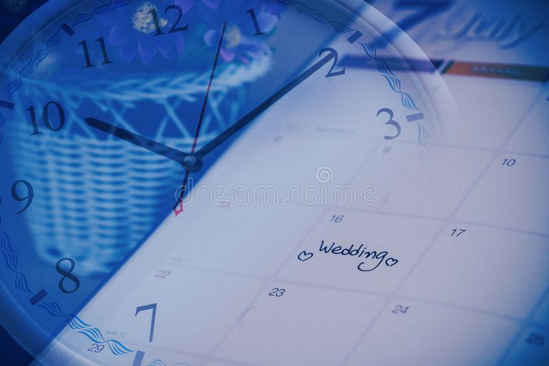 Reminder Wedding day in calendar planning time. With color tone stock photos