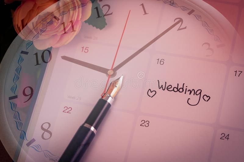 Reminder Wedding day in calendar planning time. With color tone stock image