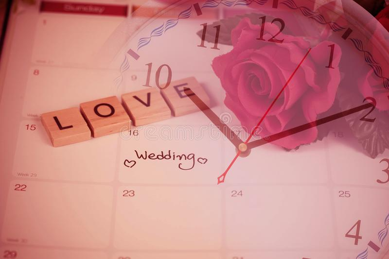 Reminder Wedding day in calendar planning time and love letter on wood. With color tone stock photos