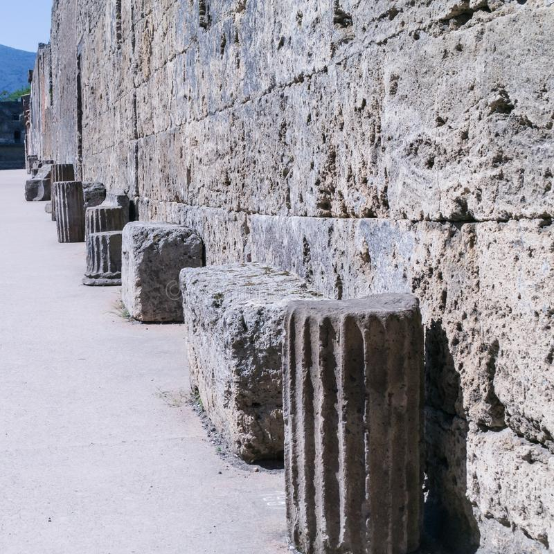 Remnants of classical columns in a street in Pompeii, Italy royalty free stock images