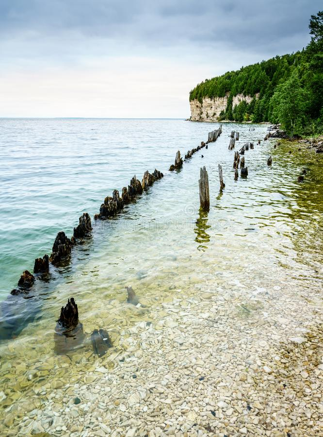 Fayette State Park shoreline. Remnants of docks in Fayette Historic Townsite in Michigan royalty free stock image