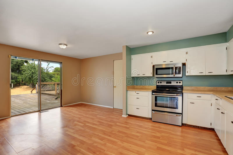 Remodeled kitchen with stainless steel appliances. Remodeled kitchen with stainless steel appliances and hardwood floor. Has exit to the back deck. Northwest stock photo