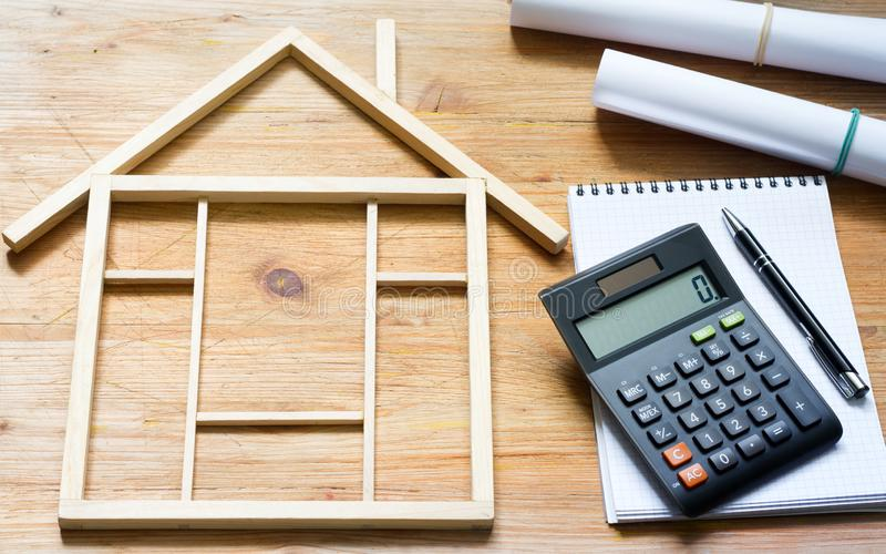 Remodeling construction valuation of home renovation abstract with calculator and plans. Background royalty free stock image