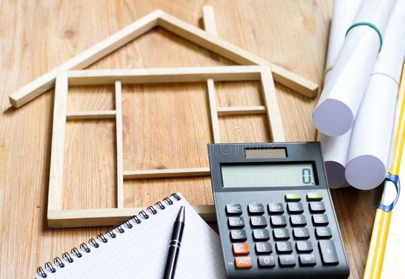 Remodeling construction valuation of home renovation abstract with calculator and plans. Background stock photo