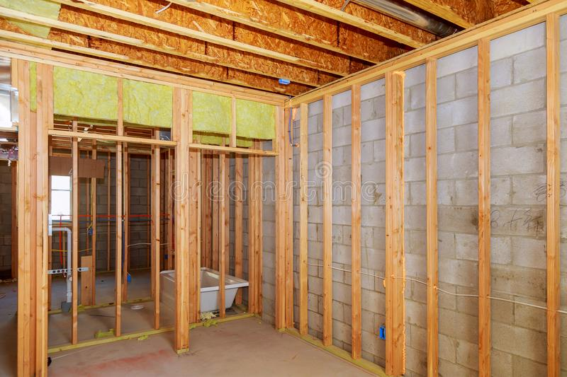 Remodeling a home bathroom, moving plumbing for new sinks royalty free stock images