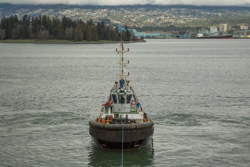 Remolque el puerto del infante de marina del fondo de la superficie del agua del océano del barco fotos de archivo libres de regalías