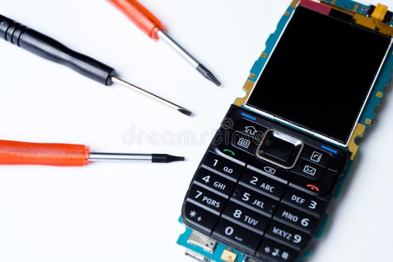 remontowi telefon komórkowy narzędzia fotografia stock
