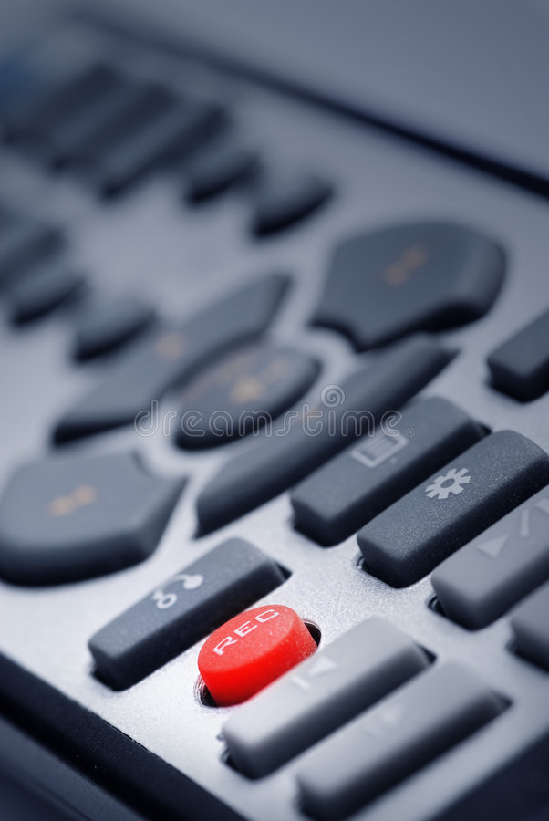 The Remote. Remote controler in design light with Red button stock images