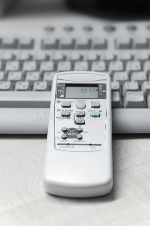 Remote control of air conditioner in office stock photo