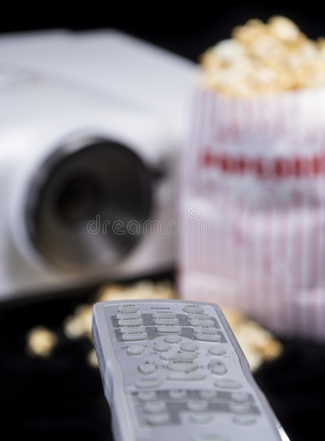 Remote Control with Beamer and Popcorn royalty free stock image