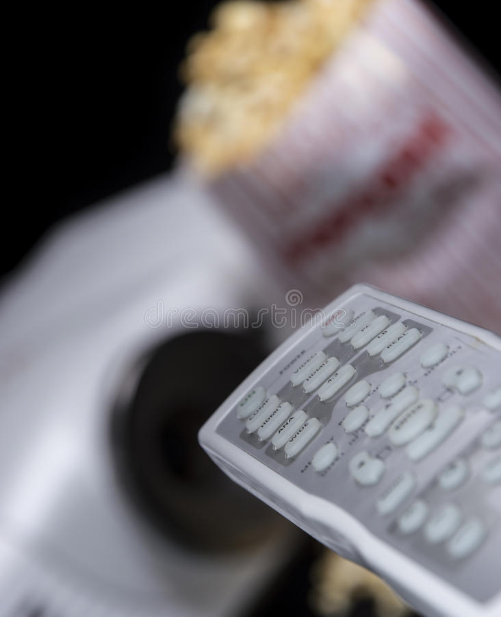 Remote Control with Beamer and Popcorn stock photo