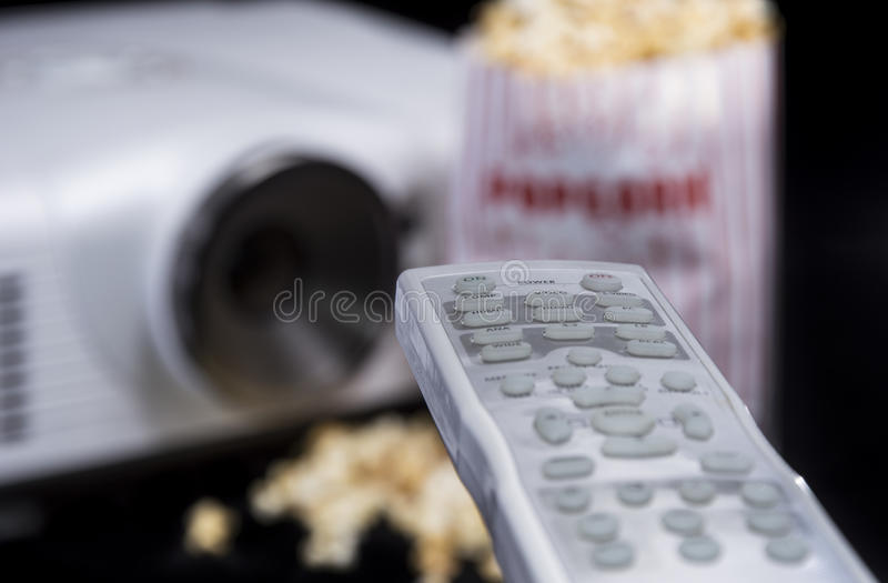 Remote Control with Beamer and Popcorn stock photography