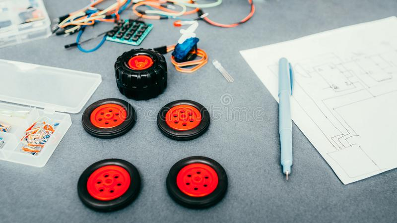 Remote control car model construction components. Remote control car model construction. Components, wheels, scheme drawing wires royalty free stock images
