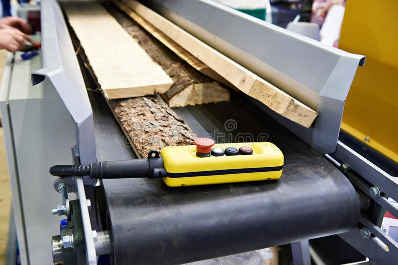 Remote control on conveyor with boards in wooden factory stock photo