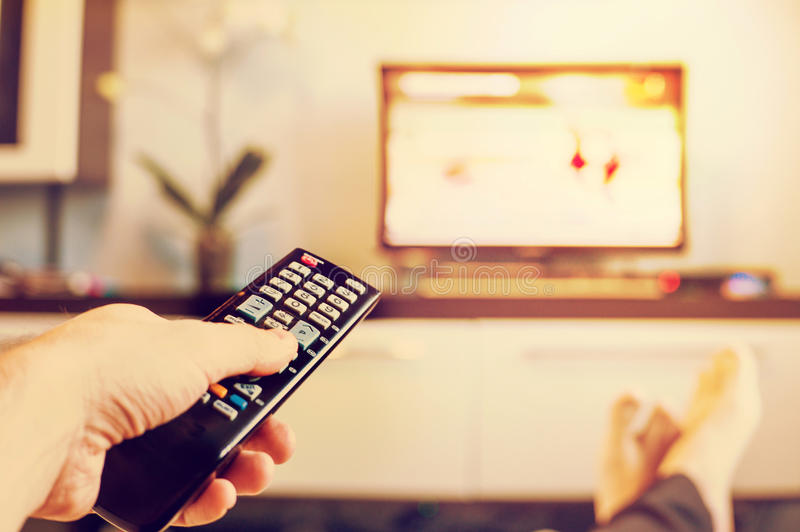 Remote control in hand closeup. royalty free stock photo