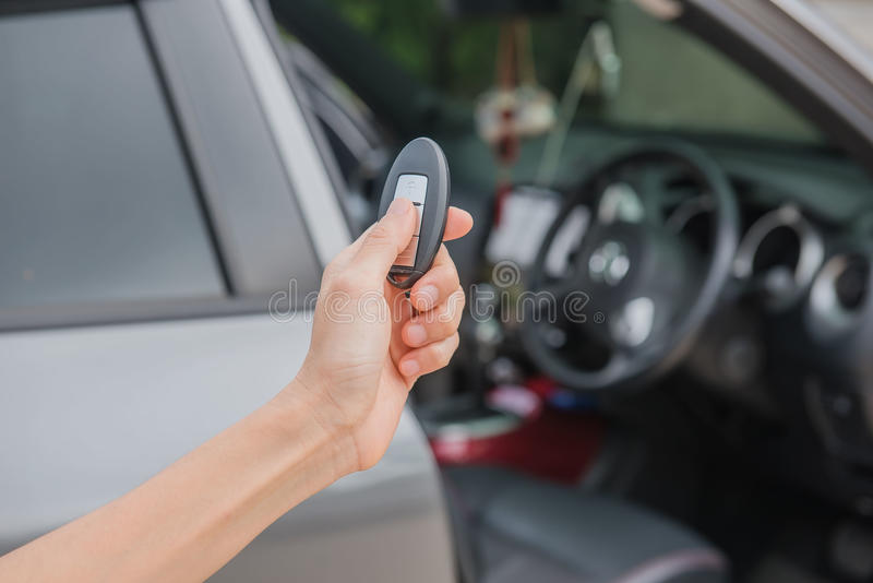 Remote control key Car in hand , system automatic.  royalty free stock photo