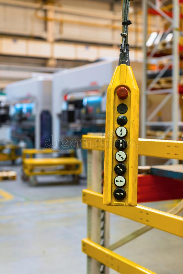 Remote control pendant switch for overhead crane in the factory royalty free stock photos