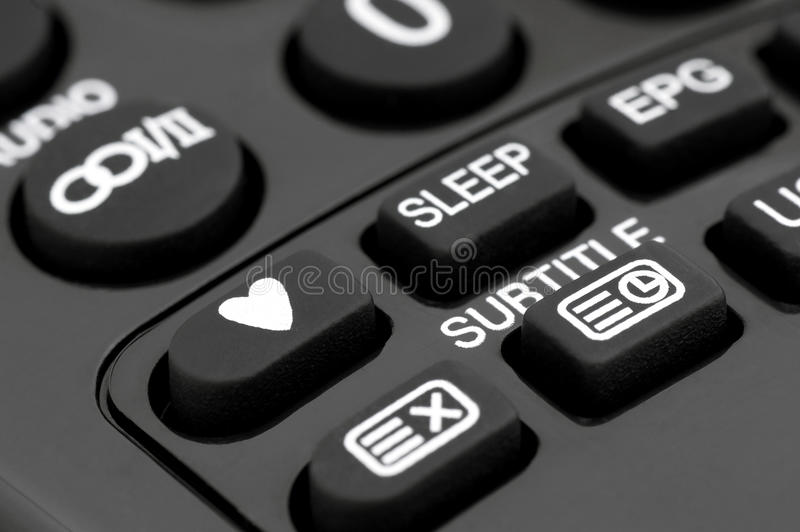 Remote control television the favorite programs. Close-up on the TV remote control-button favorite programs royalty free stock photo