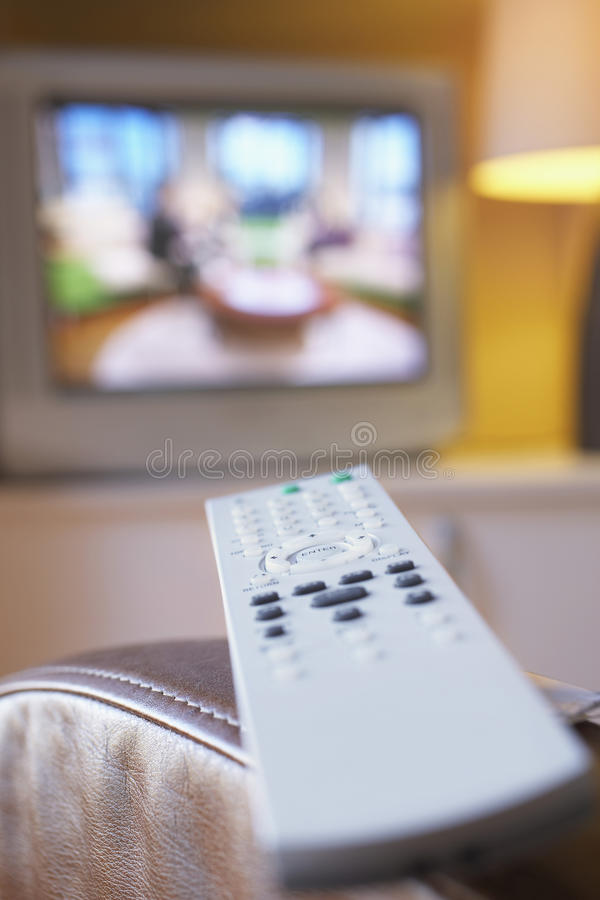 Remote Control And TV In Living Room Royalty Free Stock Photos