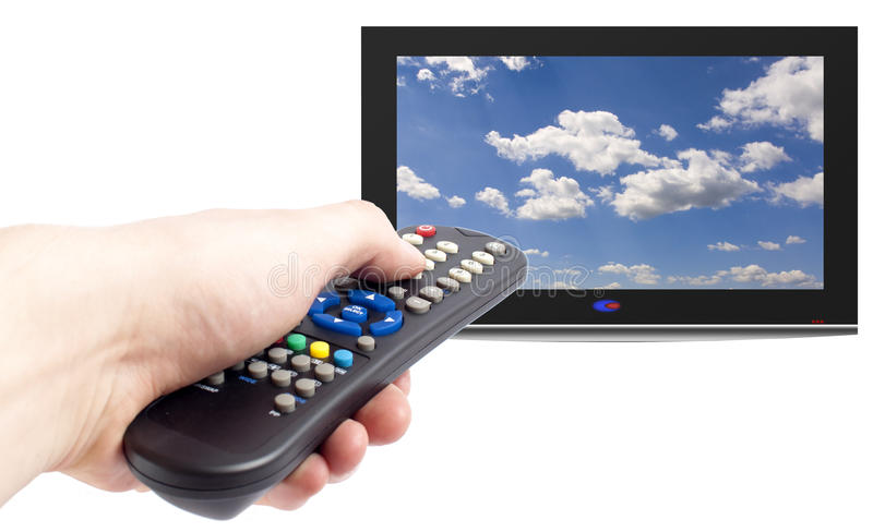 Remote control of tv set. Remote control in men hand and television set,isolated on white stock photo
