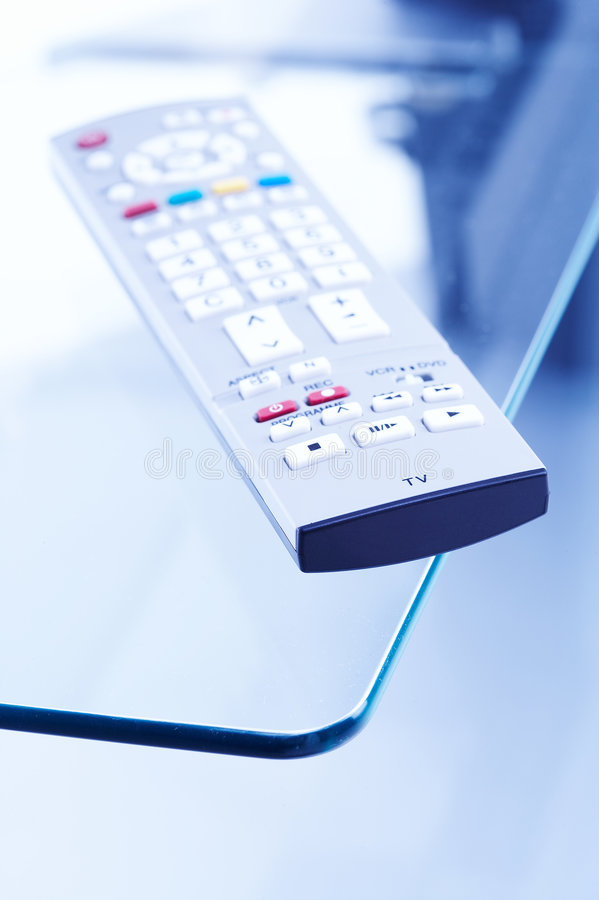 Remote Control on tv table royalty free stock photos