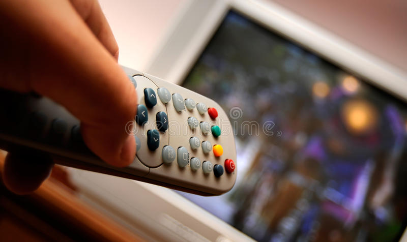 Remote control for watching TV. The TV remote control in the hand searches through the canal