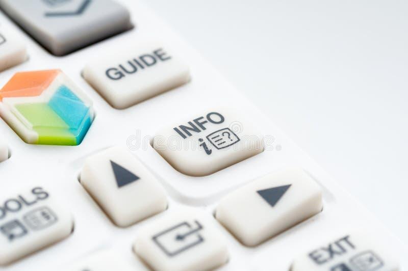 Remote controler info button. Macro shot of white TV remote controler, info button closeup stock photos