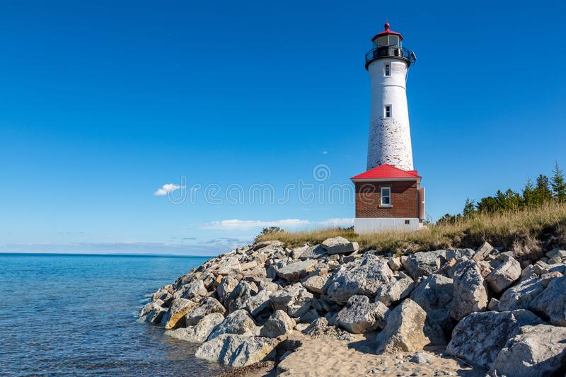 Remote Crisp Point Lighthouse on the rocky shores of Lake Superior, USA royalty free stock photography