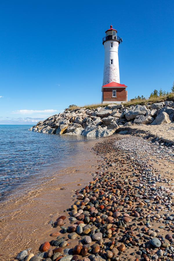 Remote Crisp Point Lighthouse on the rocky shores of Lake Superior in Michigan, USA. Remote Crisp Point Lighthouse on the rocky shores of Lake Superior in the stock image
