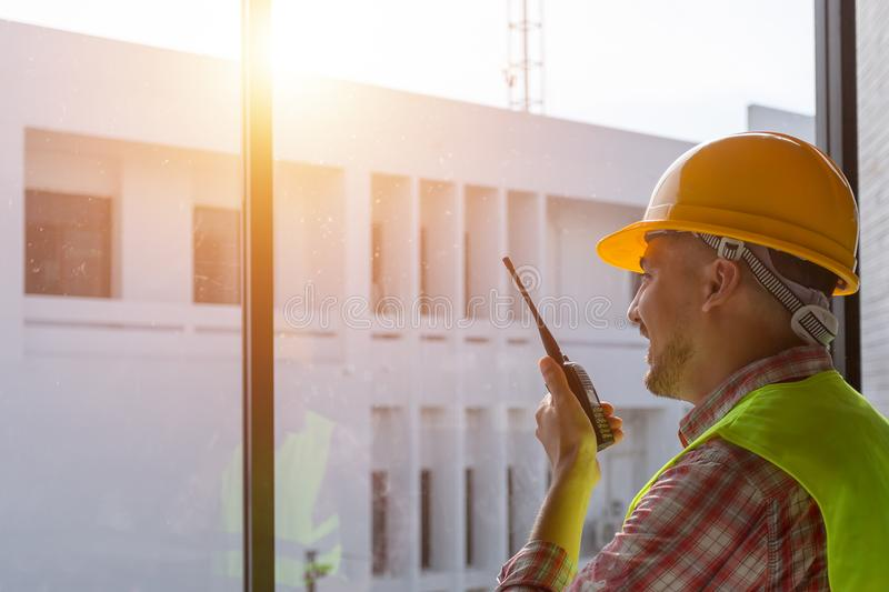 Remote engineer with radio communication in construction. stock photography