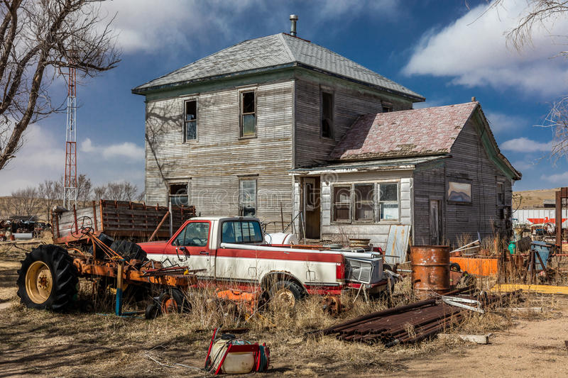 Remote falling down house and junk yard surrounding it, Nebraska royalty free stock images