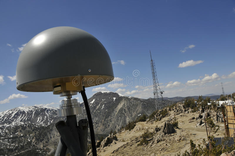 Remote GPS Antenna on Mtn.Peak. Remote GPS Antenna Station on Top of Mountain Peak with Telecommunication Towers royalty free stock photo