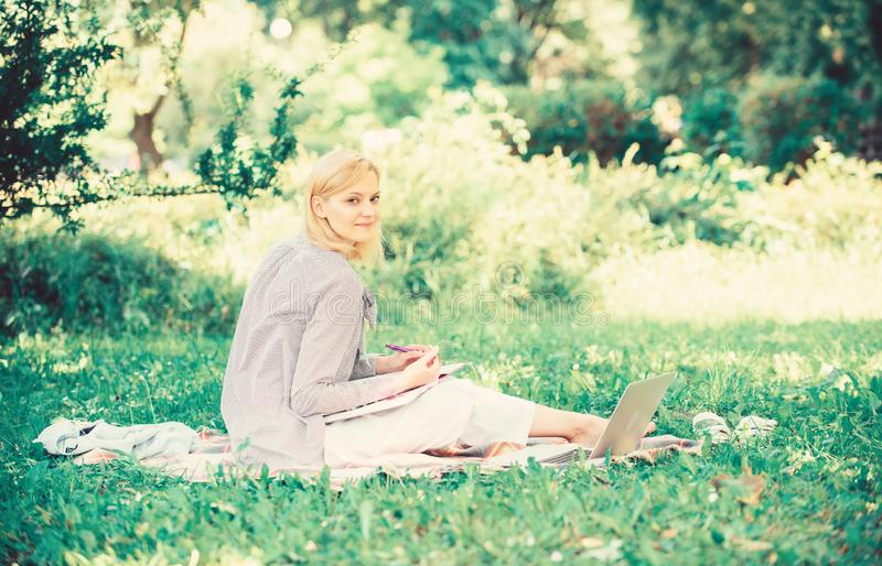 Remote job concept. Stay free with remote job. Managing business remote outdoors. Woman with laptop sit grass meadow stock photos