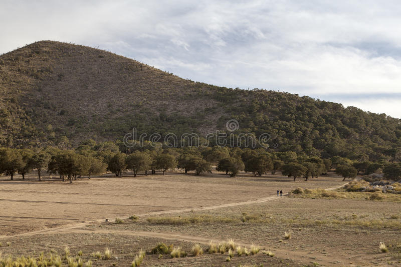 Remote landscape on way to Jalapa in Mexico. Two men walk on a remote trail on the way to Jalapa, in Mexico royalty free stock photos