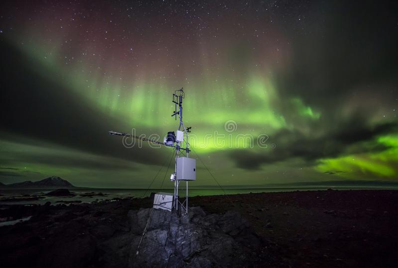 Remote meteo station with Northern Lights - Arctic, Spitsbergen. Svalbard stock photo