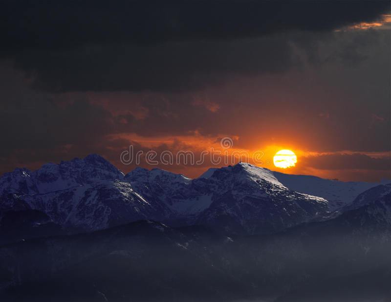 Remote mountains in sunset stock images