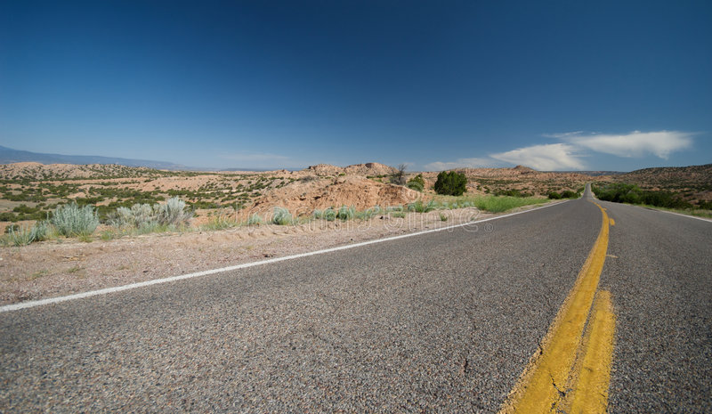 Remote New Mexico Highway. In the middle of the day stock photography