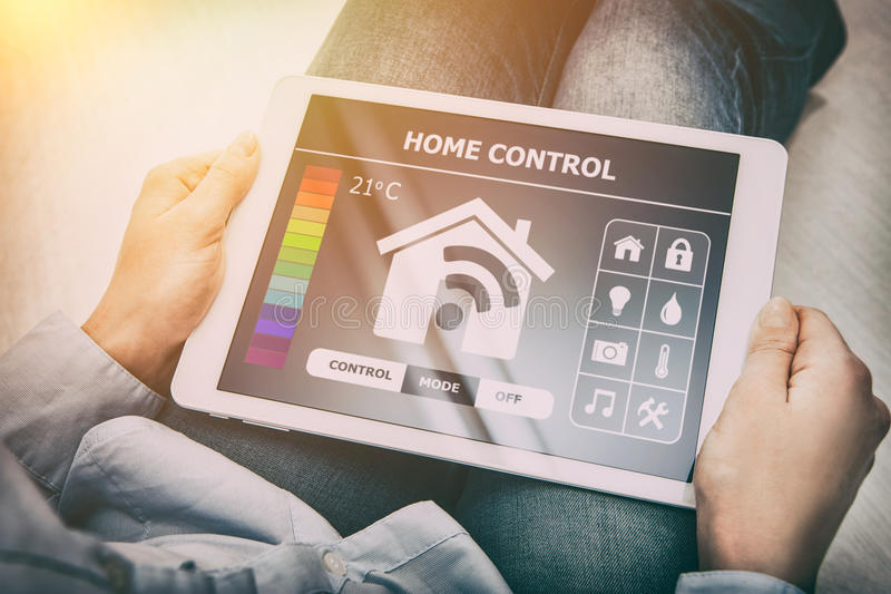 Remote smart home control system on a digital tablet. stock photo